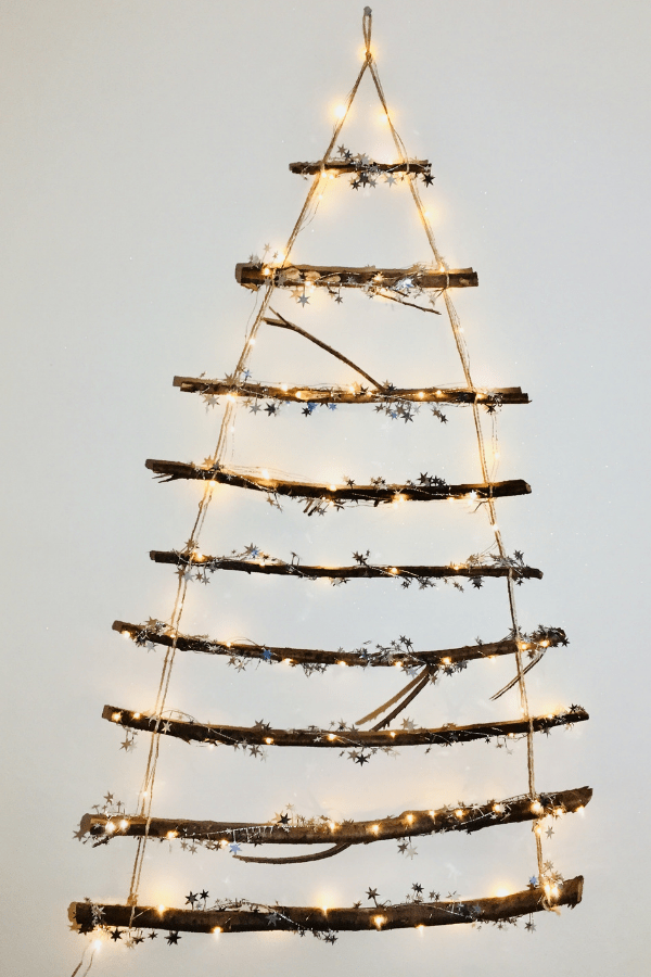 How To Make This DIY Stunning Twig Christmas Tree You Can Make In Less Than 30 Minutes | DIY Christmas Decorations | Rustic Christmas tree | DIY Christmas tree Via https://themummyfront.com #christmastreeideas #christmastree #diychristmascrafts #diychristmasdecorations