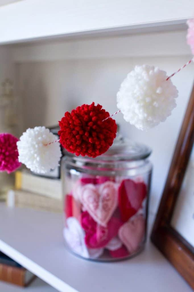 14 Stunning Valentine's Day Decoration Ideas you Will Seriously Fall In Love With This Year! #valentinesdaydecorationideas #valentines #valentinesdaycrafts #valentinesdecor Valentines decor for the home, pom pom garland