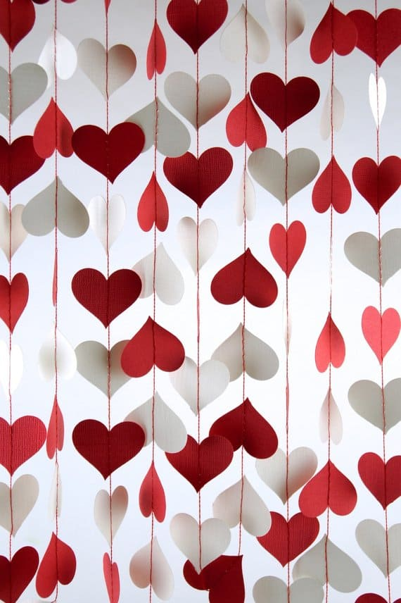 14 Stunning Valentine's Day Decoration Ideas you Will Seriously Fall In Love With This Year! #valentinesdaydecorationideas #valentines #valentinesdaycrafts #valentinesdecor Valentines decor for the home, DIY Heart Garland