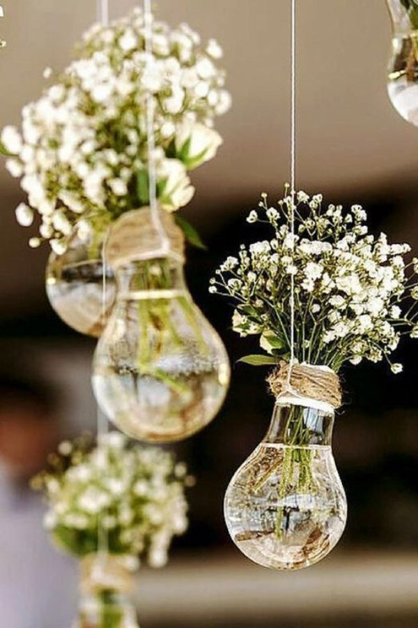 These Glass light bulb wedding decorations are stunning filled with baby's breath