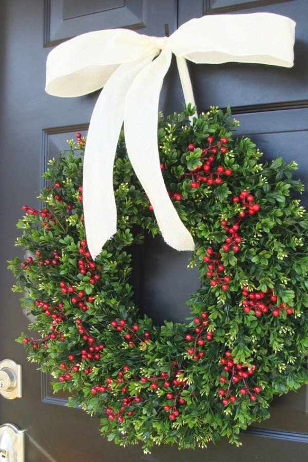 The stunning red and green touches on this wreath make it one of the best Christmas wreaths this year