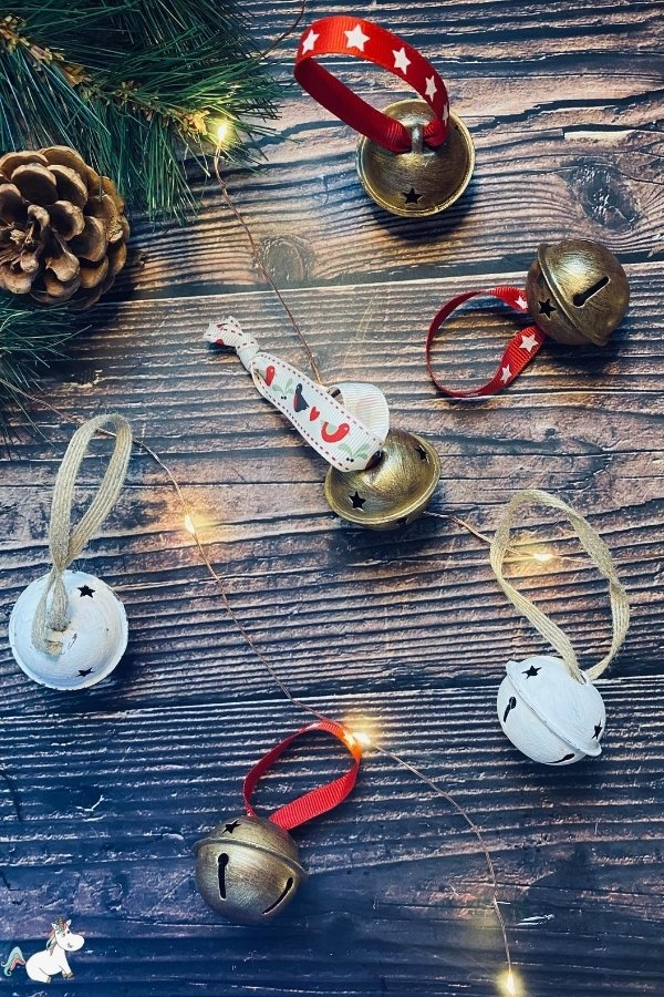 Stunning DIY Rustic Christmas Bells! The perfect DIY Christmas ornament for people who love rustic style decor #christmasbells #diychristmasdecorations #diychristmasdecor #rusticchristmas