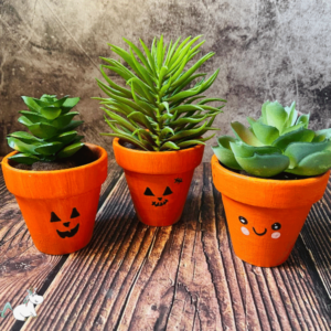 Stunning DIY Halloween Flower Pot Craft: The perfect Halloween craft to make and sell! #halloweencraft #diyhalloween