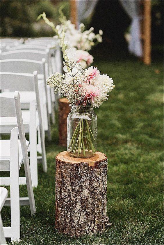 Mason Jar Vases On Logs Wedding Aisle Decor