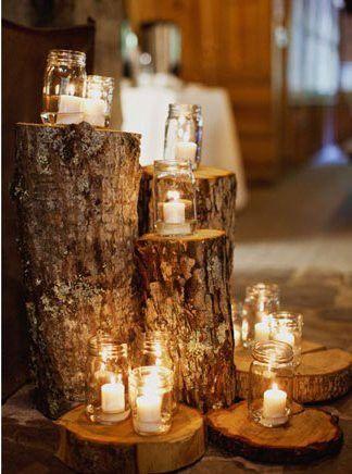 Mason Jar Lighting Display On Logs