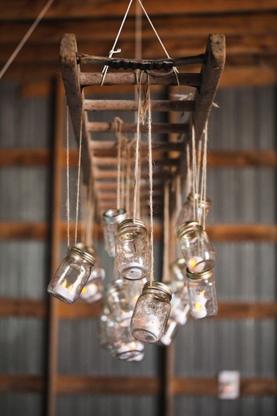Mason Jars Hung From A Rustic Ladder