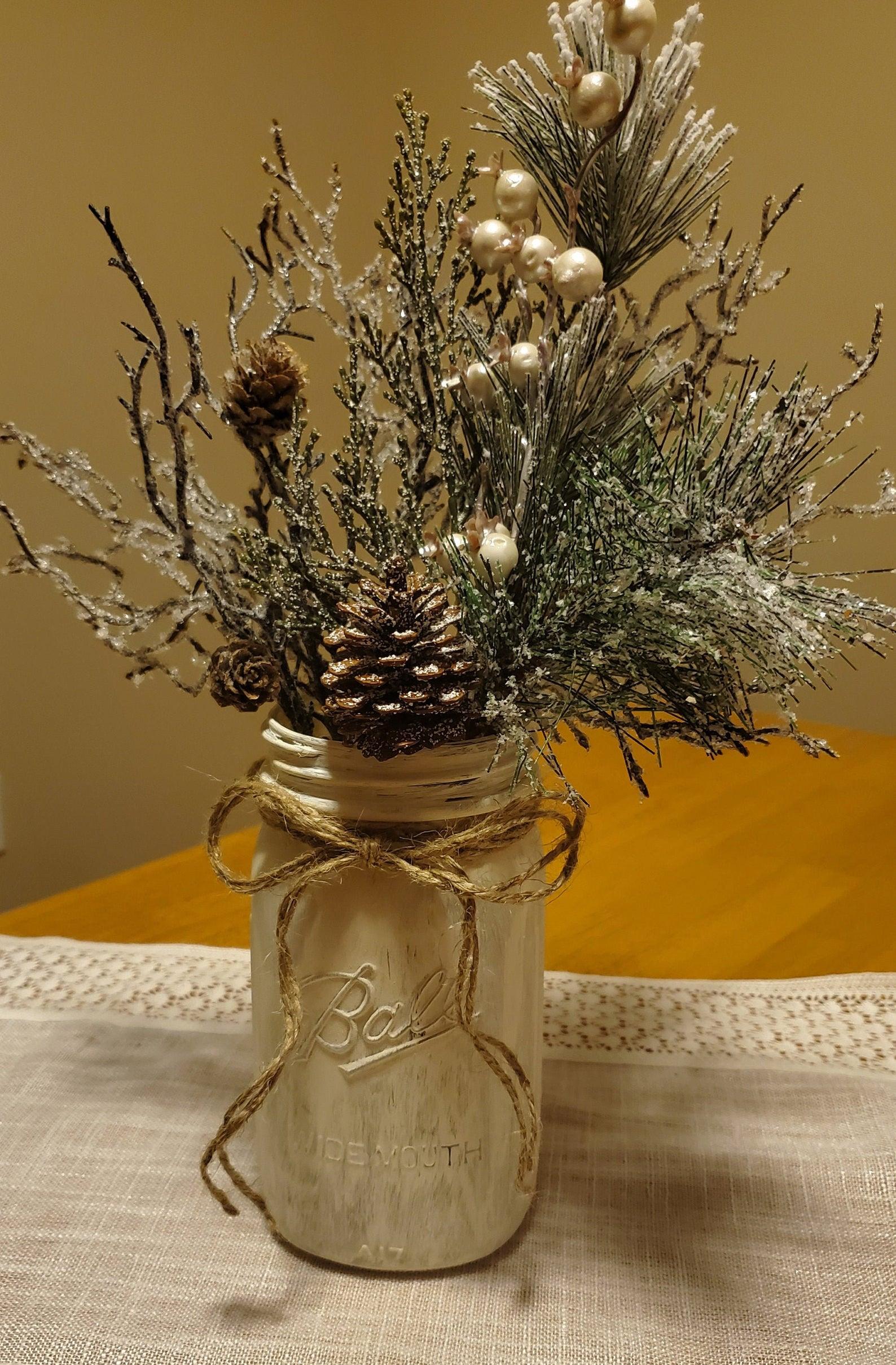 Pine filled gold mason jar