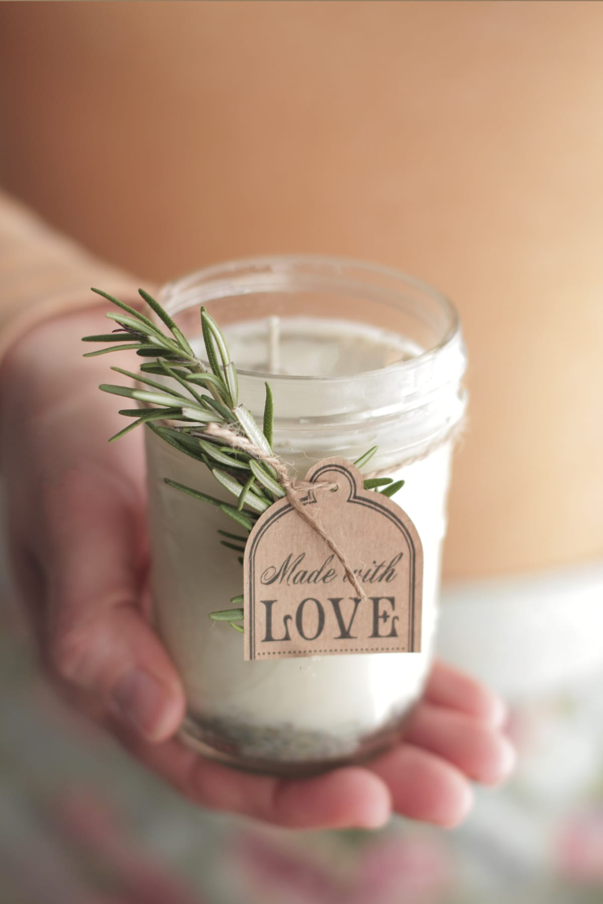 Homemade rosemary and lavender candles make the perfect favor for your guests!