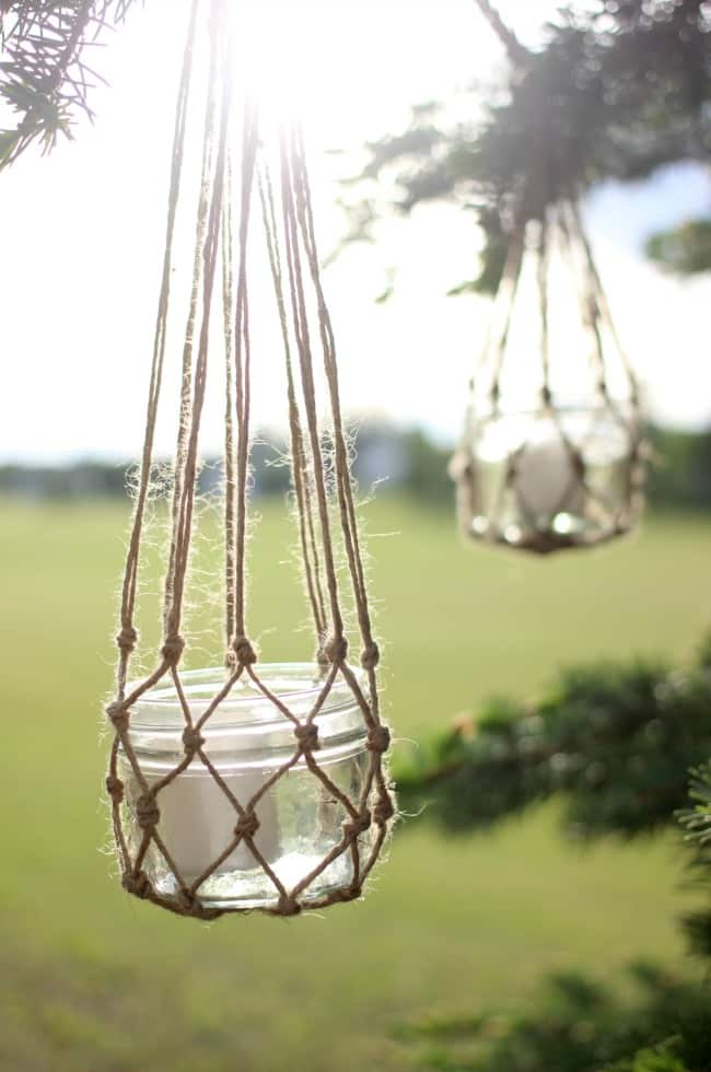 These hanging jute lanterns are one of our favorite wedding mason jar ideas!