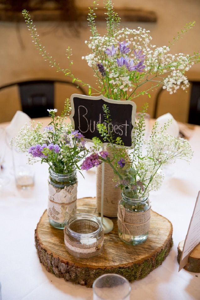 rustic wedding mason jar ideas like this centerpiece are easy to DIY and look beautiful
